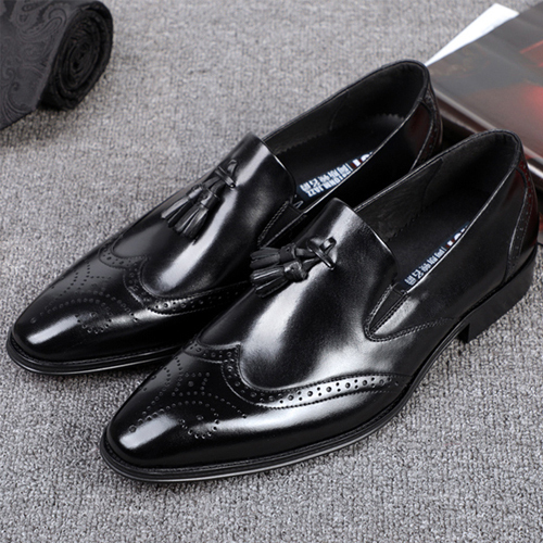 کفش مردانه چرم دست دوز هشترک زنگوله ایکفش مردانه چرم دست دوز هشترک زنگوله ای